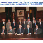 Derek Bryson Park (Standing second from the right) pictured at the signing of the Organizational Certificate to replace the Original Certificate lost in the attack of September 11, 2001 with (Seated Left) US HUD Assistant Secretary for Housing & FHA Commissioner, John C. Weicher; (Seated Center), Chairman of the US Federal Housing Finance Board/Agency, John T. Korsmo