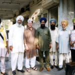 Derek Bryson Park and the Granthi (Priest) and members of the congregation of a Sikh temple, Kolkata (formerly Calcutta), India
