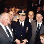 [Left to Right] Former New York Governor Hugh L. Carey; President of the New York City Economic Development Corporation, Michael G. Carey; Commissioner of the Office of Emergency Management, John T. Odermatt; Dr. Angelo J. Acquista; and Derek Bryson Park at the promotion ceremony of Commissioner Odermatt to the Assistant Chief of the New York Police Department (NYPD)